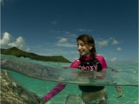 Girl Plays With Sting Rays, Photos courtesy of Tahiti Tourisme