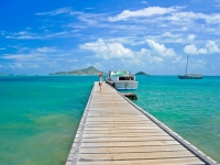 Young woman tourist on wooden jetty and beautiful Caribbean Sea, Carriacou Island, pkazmierczak